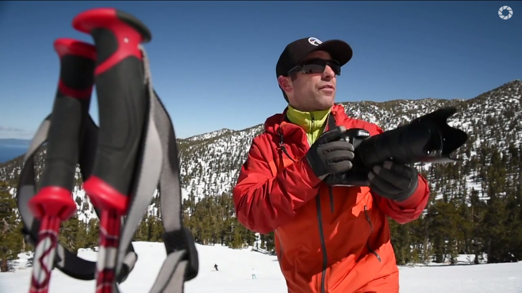 Photo of Corey Rich demonstrating how to photograph skiers.
