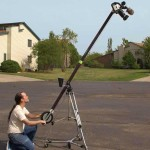 Photo of a man operating a camera jib.